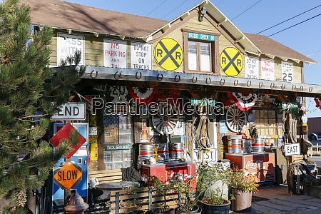 house covered in road signs goldfield