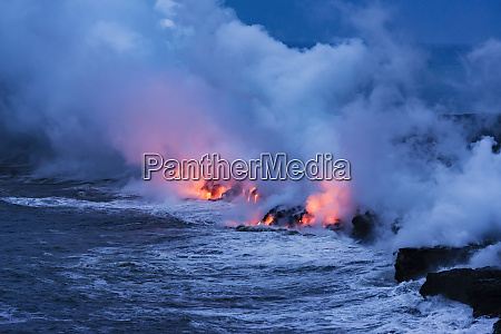 lava flow entering the ocean at