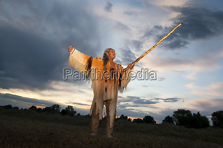 native american medicine man dressed in
