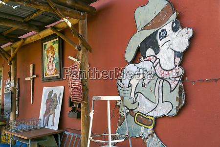 ragged cartoon character sign joshua tree
