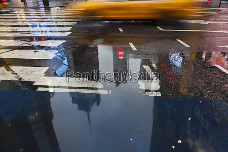 yellow cabs and reflections in times