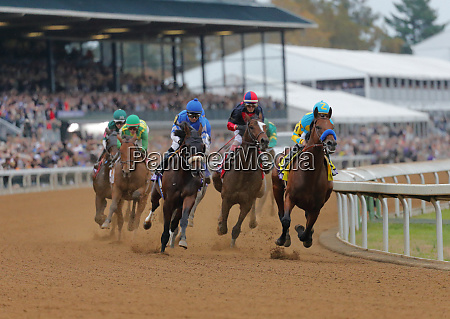 american pharaoh leads around the first