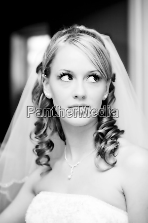 a beautiful bride poses in her