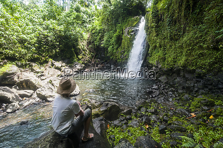 woman looking at the nikotoapw waterfall
