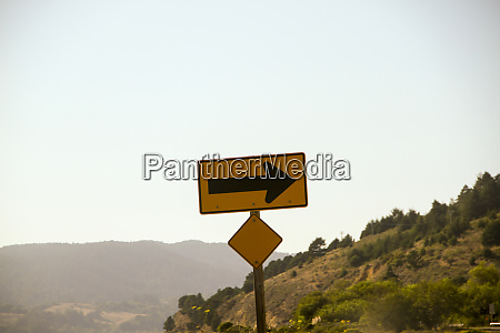 sign along the twisting roads of