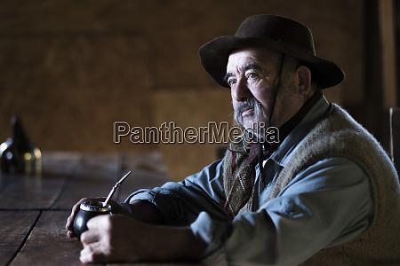 argentina elderly gaucho with mate gourd