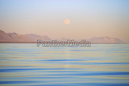 arctic svalbard longsfjorden moonrise rises above
