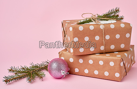 stack of kraft paper wrapped gifts