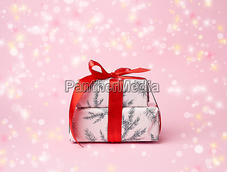 two boxes wrapped in christmas pink