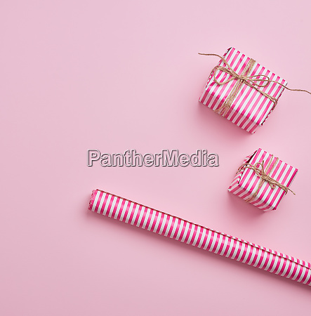 two gifts wrapped in pink striped