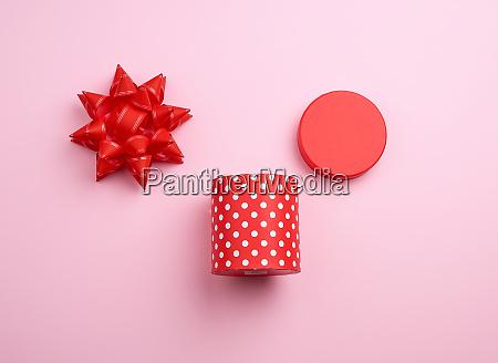round red cardboard box in white