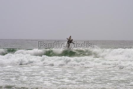 surfing along carmel coastline california