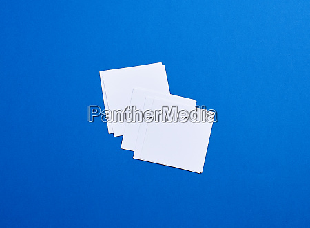 empty white small square sheets of