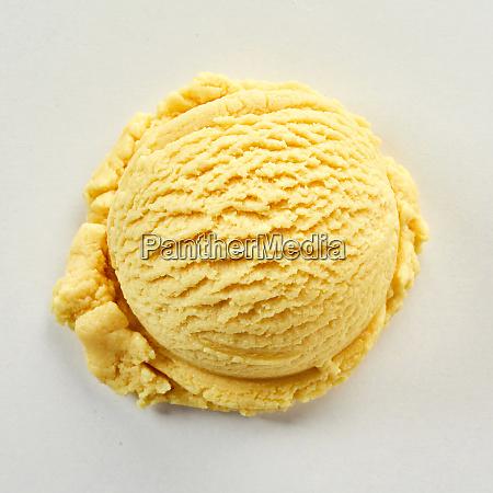 scoop of yellow ice cream in