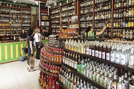 south america brazil paraty tourists buying