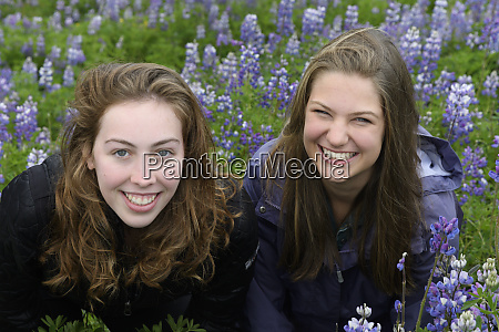 iceland young women smiling in lupine