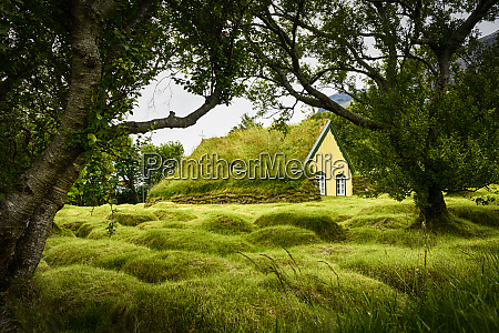 iceland turf roofed hof church and