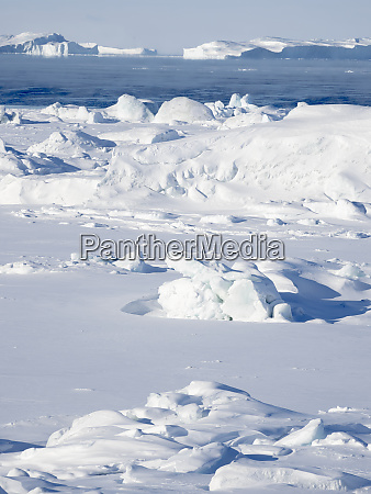 frozen disko bay with icebergs at