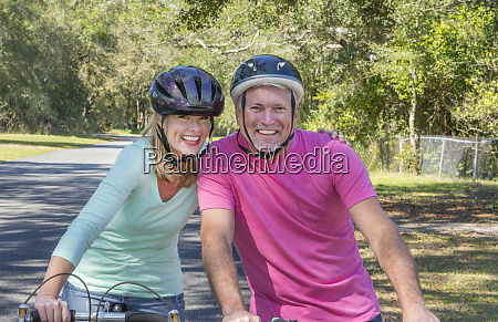 couple aged 40s and 50s riding