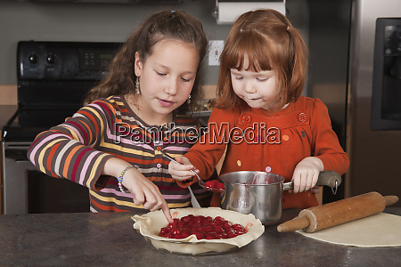 sisters adding cherry pie filling to