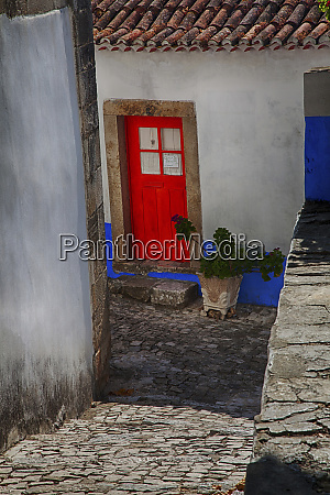portugal obidos bright red door of