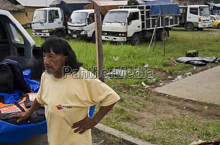 huaorani indian wearing oil company t