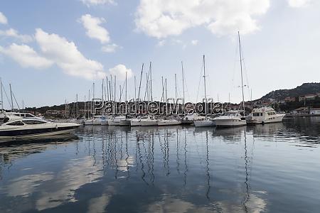 italy sardinia costa smeralda boat dock