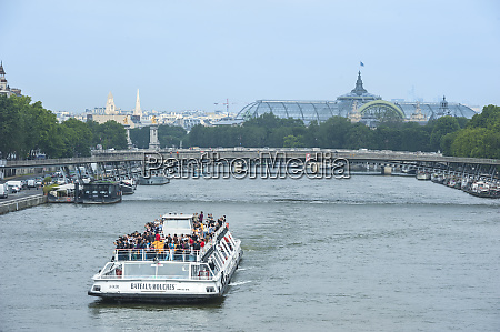 sightseeing boat along seine river paris