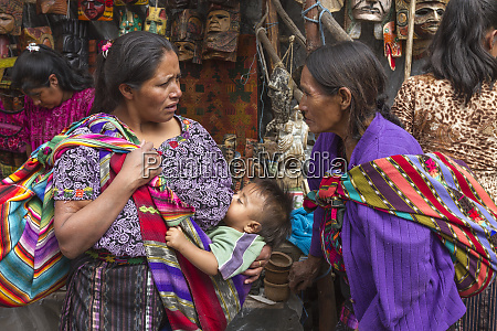 guatemala chichicastenango two mothers chat in