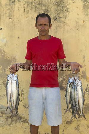 cuba trinidad a fishmonger poses with