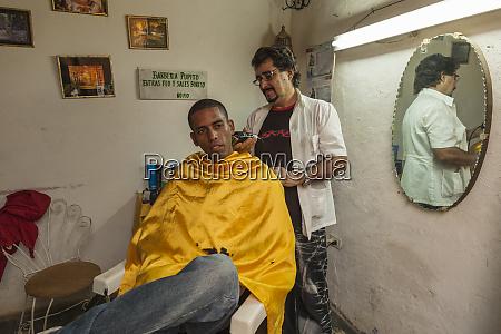 cuba trinidad man getting a haircut