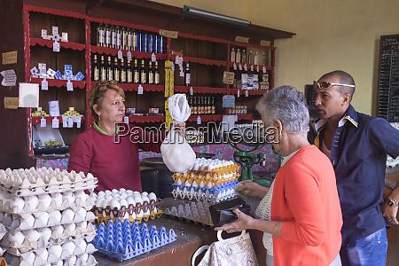 cuba trinidad buying eggs in a