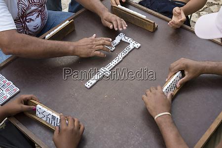 cuba trinidad men playing dominoes outdoors