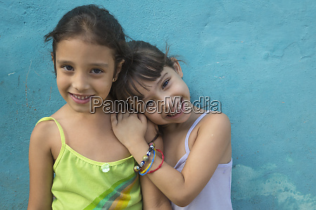 cuba trinidad two sisters happily pose