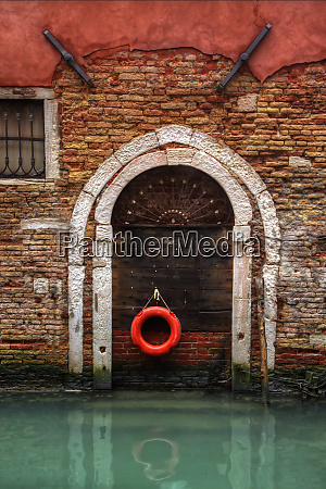 doorway along canal with safety buoy