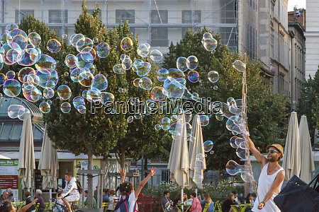 children playing with soap bubbles place
