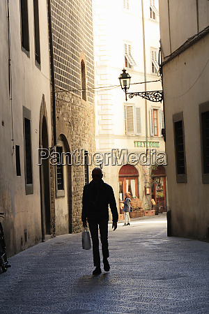 italy florence silhouette of person waking