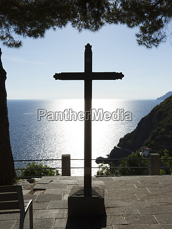 religious symbol facing ocean