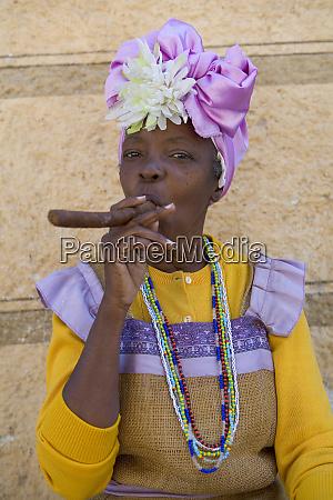 cuban woman smoking a cigar havana