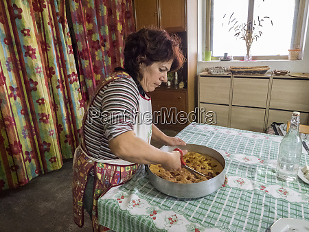 italy alberobello local woman cutting up