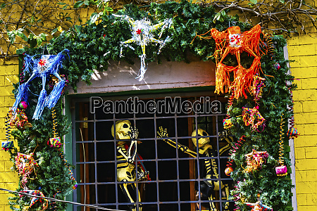 colorful pinatas day of the dead