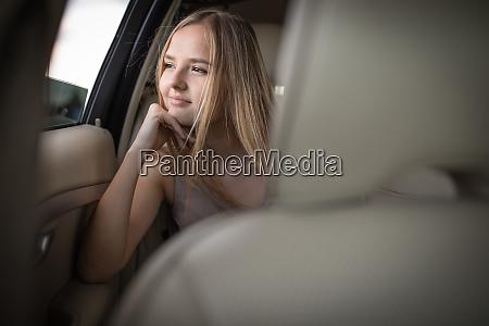 cute teenage girl in a car
