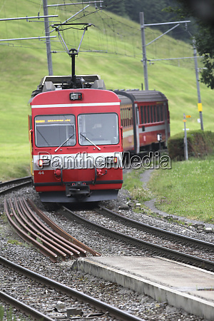 local swiss train departing small village