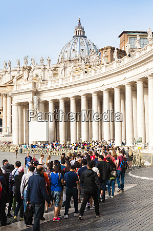 tourists queuing berninis 17th century colonnade