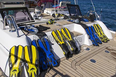 italy sardinia snorkel gear on deck