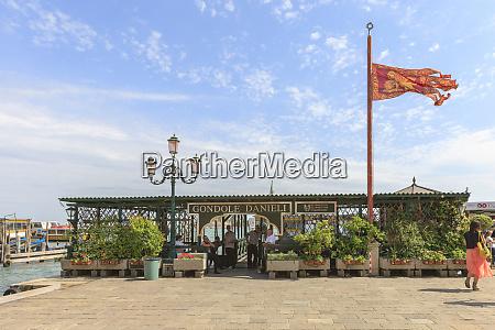 gondola pier venetian banner venice italy