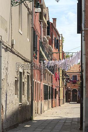 narrow street murano island venice italy