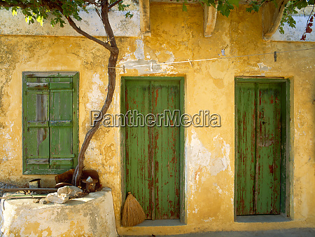 greece symi yellow house with green