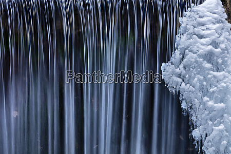 water flowes by ice formation along
