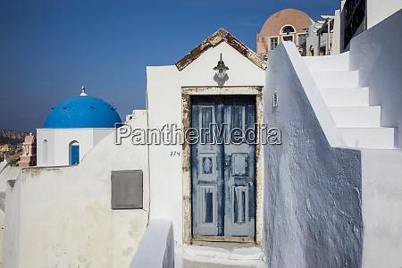 greece santorini blue door and dome